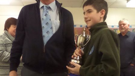 Ben is awarded a prize at a poultry show