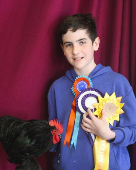 Ben with a prize for one of his winning birds
