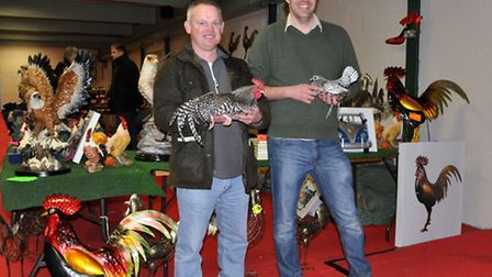Poultry show champions A J Cumming (left) and Robin Creighton with winning birds