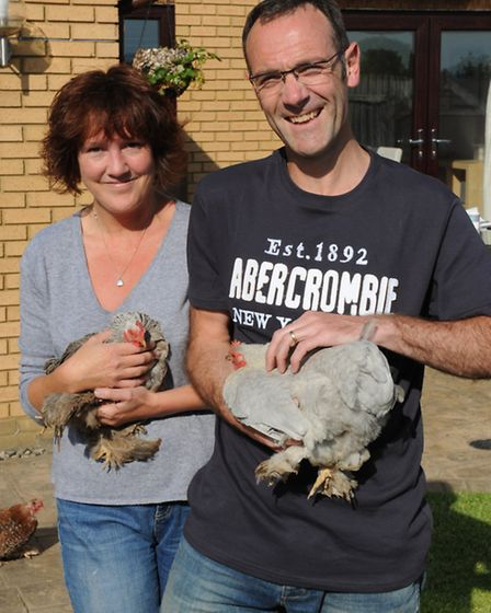 Lesley and Phil with two of their other birds, a silver partridge and lavender Pekin bantham