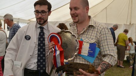 Phillippe Wilson, show judge, with Matt Clifton who won 'Best in Show'