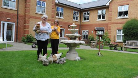 Centre manager Jude Reeves, left, with activities co-ordinator Amanda Reeve and the chickens
