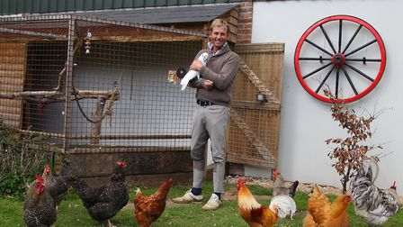 Carl with his chickens and white cockatoo - the white witch
