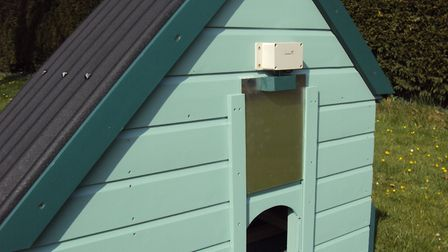 A hen house door controlled by a Chixaway closer