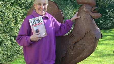 Anne Perdeaux with her book