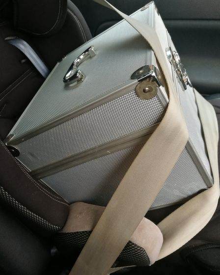 The egg box strapped securely in the child seat