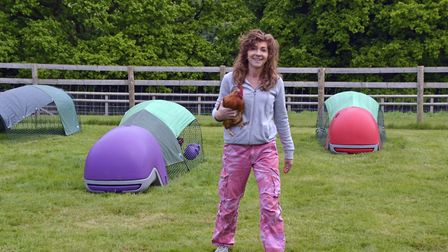 Rachel Misra among her colourful plastic chicken coops (photo: Susie Kearley)
