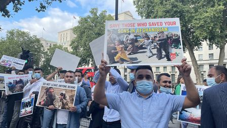 Former Afghan interpreters and veterans hold a demonstration outside Downing Street in London, calli