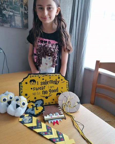 With her yellow Hufflepuff crafts is Maya, aged 10,who took part in the 1st