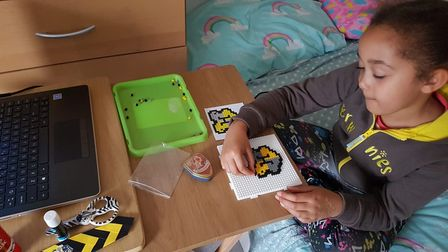 Making the hamma bead magnet is Sophia, aged 7,who took part in the 1st Toftwood Brownies Harry Potter virtual sleepover.