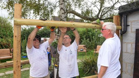 East Anglian National Lottery winners helping build a bigger stableyard for the therapy minature don