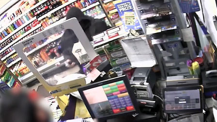 A masked robber armed with a hand gun demanded cash from a shop worker at Young's Convenience Store in Lowestoft.