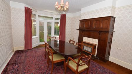 Large period-style dining room with picture rails, wooden floors and paneled fireplace