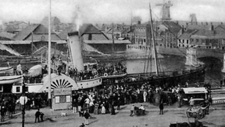 The ice houses at Great Yarmouth behind steam ferry Resolute in 1884. The Southtown mill can be seen in the background