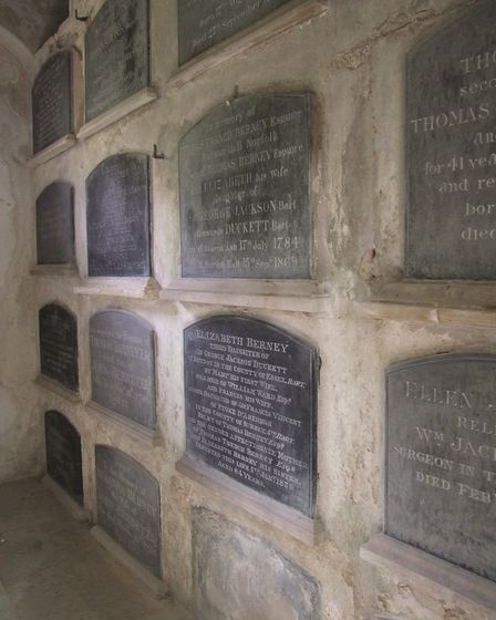 Inside the Berney mausoleum in Bracon Ash church showing the loculi that line the walls