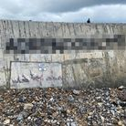 Offensive graffiti thatappeared above a Banksy artwork in Cromerhas been removed and reported to the police.