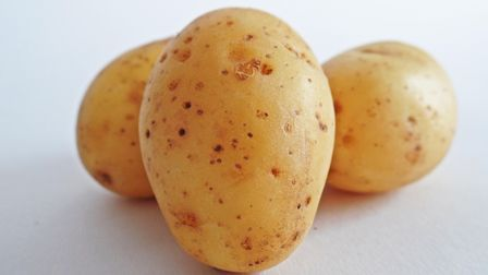 Three uncooked but clean potatoes