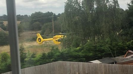 The helicopter landed in a field behind homes in Mount Pleasant