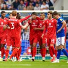 MK Dons celebrate after their second.