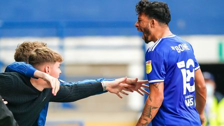 Macauley Bonne celebrates with fans after taking Town back into the lead with his second goal.