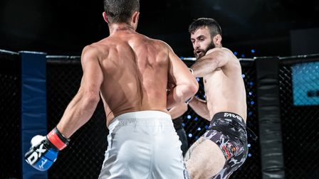 Kyle Buggs uncorks the left hand which separated Valentin Prajisteanu from his senses at Road to Contenders 3