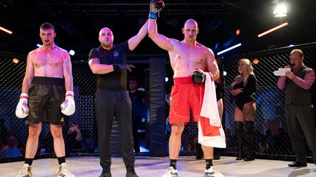 Jakub Adamski has his hand raised after beating Ben Smith on Road to Contenders 3