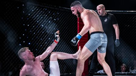 Tariq Pell stands over Thomas Callaghan on his way to a dominant decision win at Road to Contenders 3