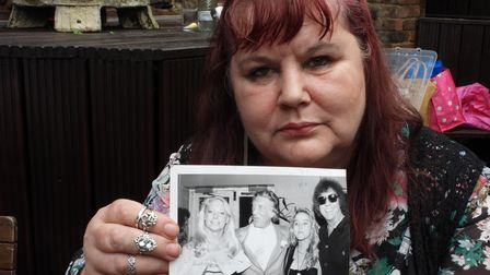 Nancy Kray with family snapshot of her dad Charlie
