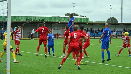 Despite his high jump, Barking full-back James Folkes misses the ball against Ilford in the FA Cup