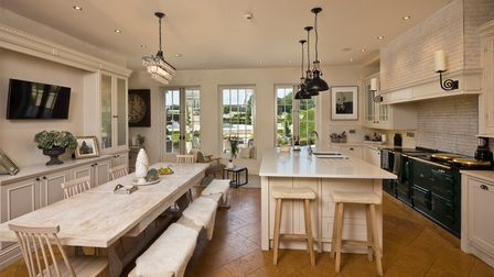 Modern country-style kitchen/breakfast room with kitchen island and bench seating