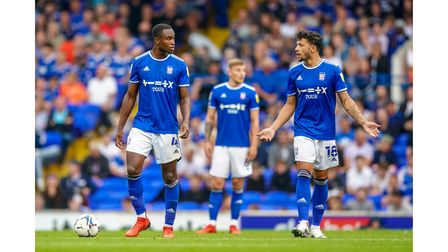 Rekeem Harper and Macauley Bonne pictured after Scott Twine had leveled for MK Dons.