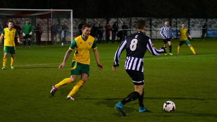 Dereham Town, black and white, in Norfolk Senior Cup action against Spixworth. Picture: JOE SAYER/NO