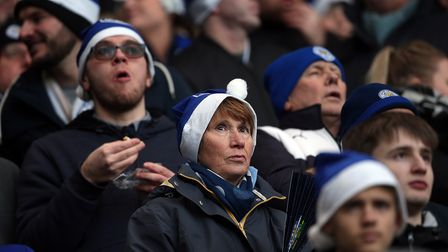 The home fans make good use of the free Santa hats provided before the Premier League match at the K