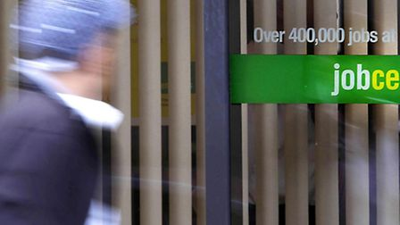 File photo dated 15/07/09 of a person passing a Job Centre Plus. Photo credit: Danny Lawson/PA Wire