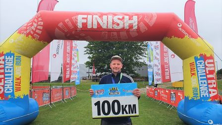Nick Winterton (pictured) at the finishing line of his Lake District 'ultra-challenge' 100km hike.
