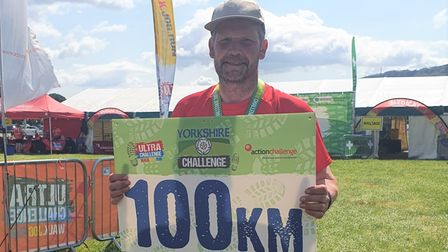 Nick Winterton (pictured) at the finishing line of his Yorkshire'ultra-challenge' 100km hike.