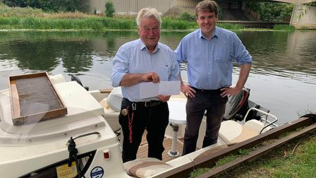 East Cambs Councillor Bill Hunt with his his son, MP Tom Hunt, and a birthday card from Prime Minister Boris Johnson