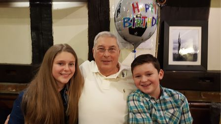 Mike Ford on his 70th birthday with two of his grandchildren, Astrid and Blake