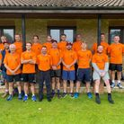 Group in matching orange tshirts ahead of a 48-mile walk starting at Takeley Cricket Club, Essex