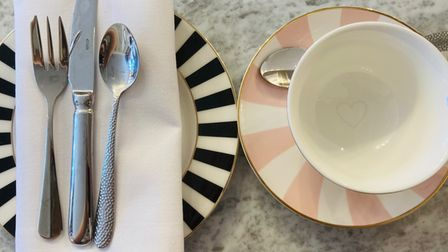 Cups, saucers and cutlery at The George Colchester