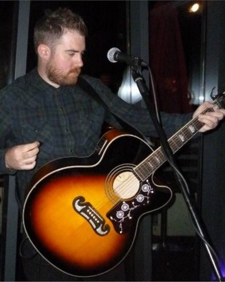 Jamie McGuire with a guitar. He will perform at Dunmow Cricket Club, Great Dunmow, Essex