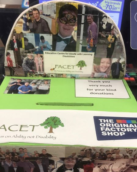 Some of the students who attend FACET made the store a charity box for funds to be stored safely in.