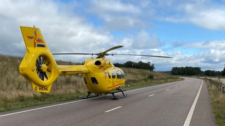 The air ambulance landing on the A11 this morning.