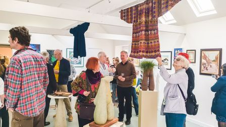 People inside the West Acre Gallery.