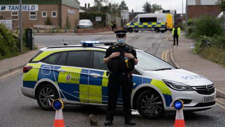 An Essex Police officer guarding the Enterprise Court industrial estate in Braintree after a man was stabbed