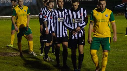 Action from the clash between Dereham Town, black and white, and Spixworth. Picture: JOE SAYER/NORFO