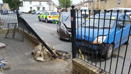 Several cars have crashed into a wall and set of railings in Cottenham High Street this afternoon.