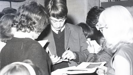 Charlie Watts signing autographs when the Rolling Stones playedthe Ipswich Gaumont on October 9, 1964