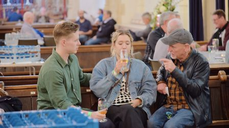 Festival-goers enjoy a tipple in St Edmundsbury Cathedral