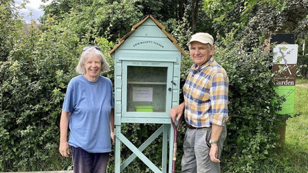 The seed library set up at the community garden in Framlingham. L-RStephanie Bennell and Derek Johnson